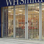 FlexiGlide sliding folding shutter installation in shopping centre