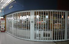 A folding shutter with glass panels.